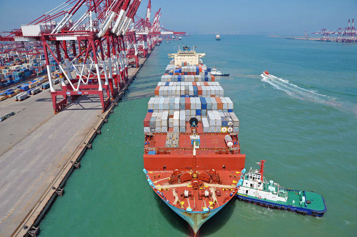 Vessel berthing at the Port of Qingdao, China container terminal.