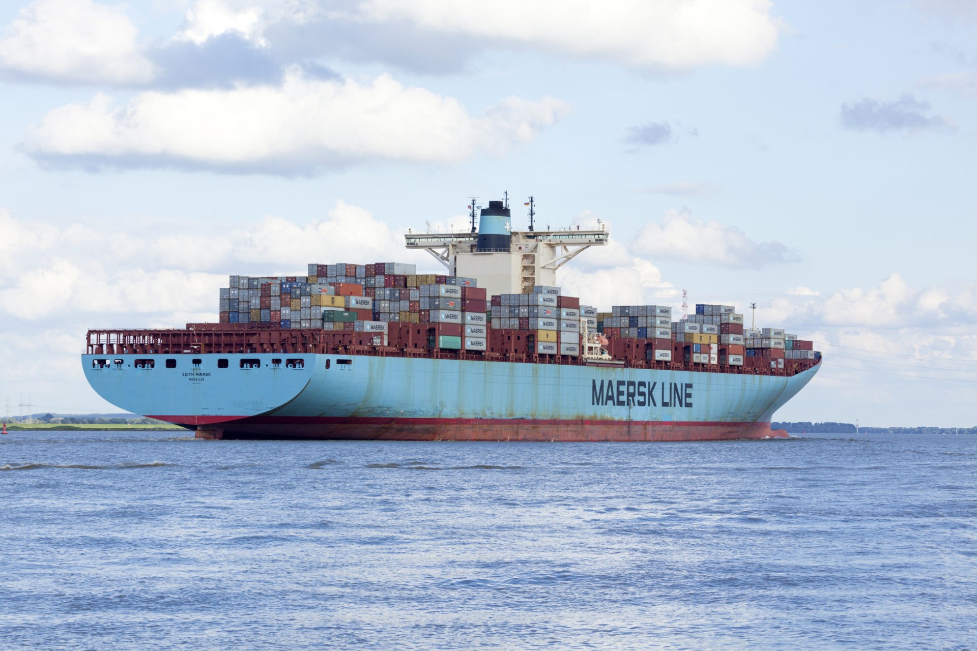 Stade, Germany - August 21, 2016: EDITH MAERSK, one of the world's largest cargo ships, operated by Danish shipping company Maersk Line, near Hamburg on Elbe river.