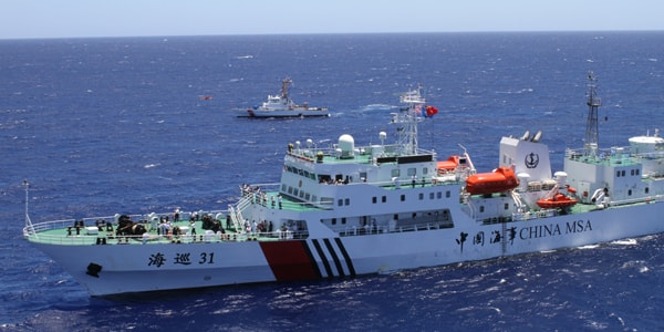 The crew of the U.S. Coast Guard Cutter Galveston Island (background), home ported in Honolulu, is underway alongside the crew of the People's Republic of China Maritime Safety Administration ship Haixun 31 (foreground) eight miles offshore of Honolulu, Sept. 6, 2012. The ships took part in a joint rescue exercise which included Haixun 31's helicopter crew and an MH-65 Dolphin helicopter crew from Coast Guard Air Station Barbers Point. U.S. Coast Guard photo by Petty Officer 2nd Class Eric J. Chandler.