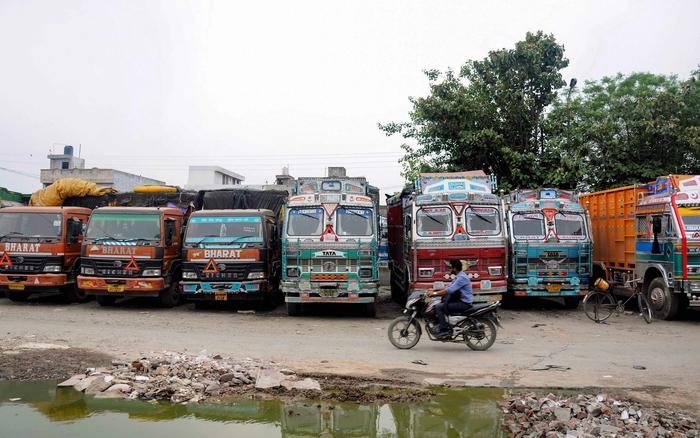 A motorist rides past trucks parked at a Jahar Ghar in Amritsar. Photo Credit: PTI