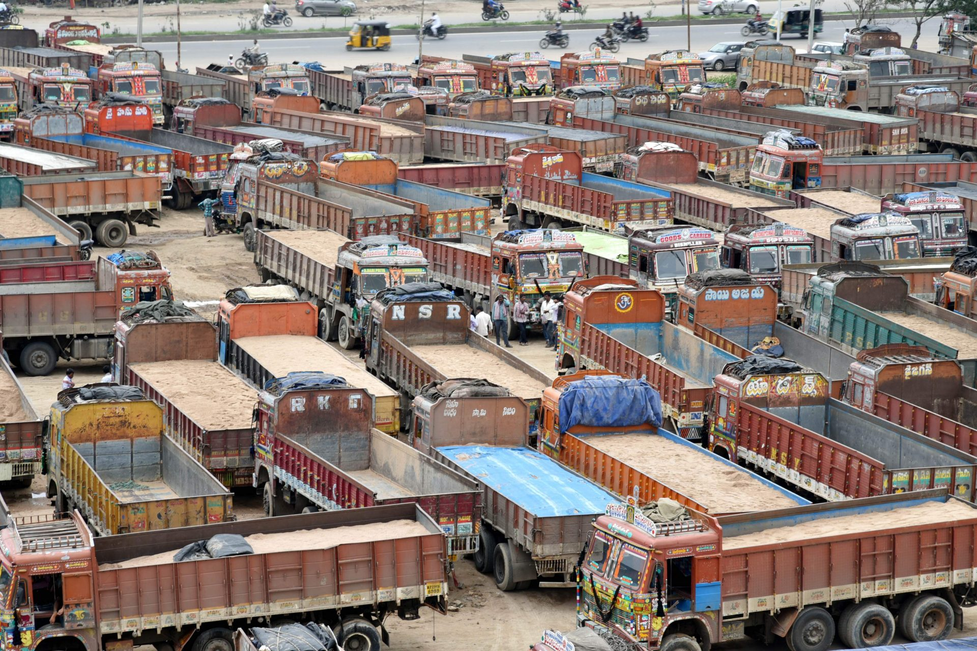 Trucks idle near Vanasthalipiram, Hyderabad, India during the July 2018 Trucker Strike. Photo Credit: R.Satish Babu, Express.