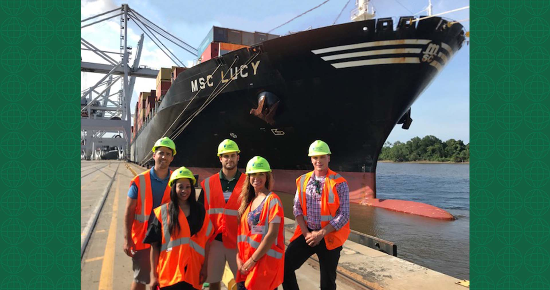 UWL Employees pose in front of the container vessel MSC Lucy at the Port of Savannah. From left to right: Johnny Maiden, Latesha Mosley, Dave Pycraft (Company Tour Guide), Adrienne Parrish, Tino Nieves.