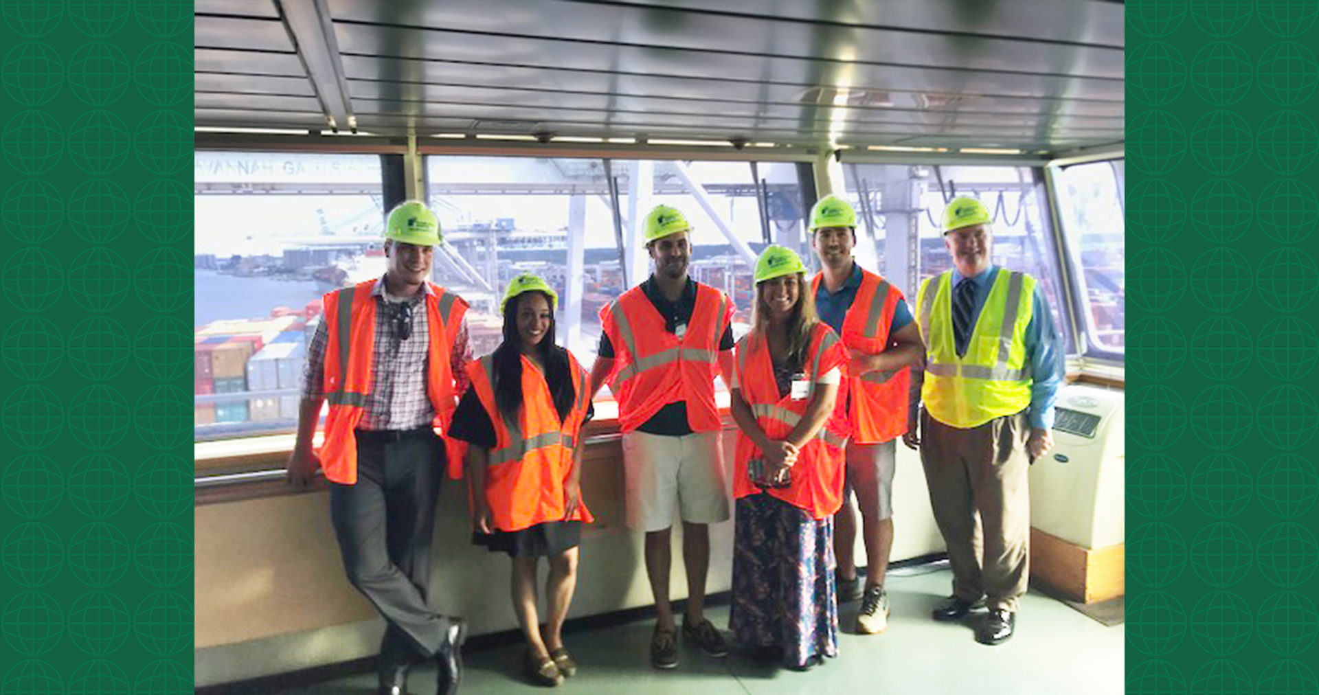 "UWL Supply Chain Award winners stand with their tour guides aboard a vessel. From left to right: Celestino ""Tino"" Nieves, Latesha Mosley, Dave Pycraft (UWL Savannah Tour Guide), Adrienne Parrish, Johnny Maiden, Bill Barrs (Regional Sales Manager, Georgia Ports Authority)"